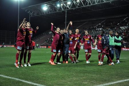 galati: CLUJ NAPOCA, ROMANIA – MARCH 26: FC CFR Cluj players celebrate the victory against FC Otelul Galati, final score 2:0 on March 26, 2012 in Cluj N, Romania