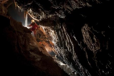 dark cave: Cave explorer, speleologist exploring the underground