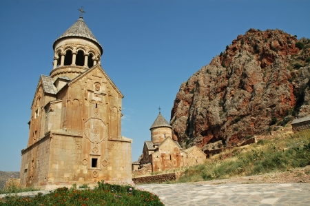 Noravank medieval monastery in Armenia, red rocks in the background