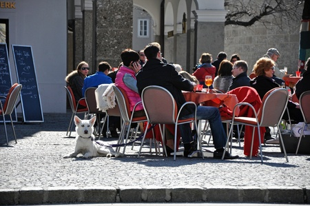 SALZBURG - MARCH 13: Tourists relaxing in the historical center of the famous Unesco heritage city of Salzburg, the city where the W.A. Mozart was born. On March 13, 2012 in Salzburg, Austria
