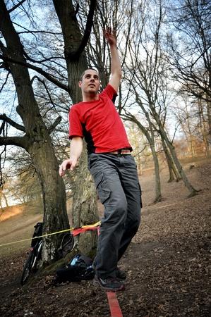 slack: Man balancing on the slackline in the outdoor