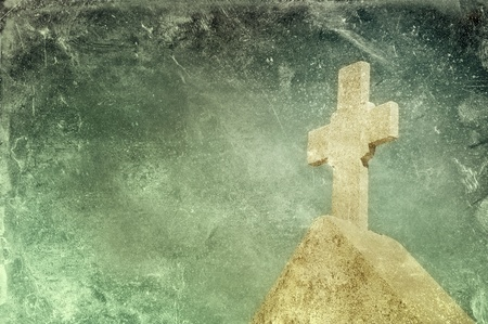 Vintage stone cross on grunge background, religious motif Standard-Bild