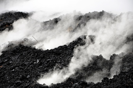 Charcoal pile burning in the outdoors, Romania Stock Photo - 13345724