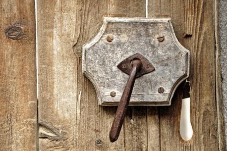 A very old door handle on a wooden door Stock Photo - 13351005