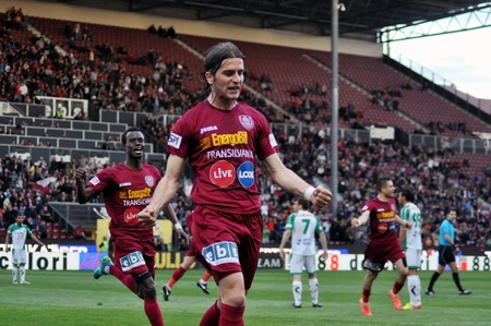 cfr cluj: CLUJ-NAPOCA, ROMANIA – APRIL 22: S. Vranjes (in red) celebrating a goal at a Romanian soccer game CFR Cluj vs. C. Chiajna, April 22, 2012 in Cluj-Napoca, Romania