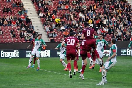 CLUJ-NAPOCA, ROMANIA – APRIL 22: S. Vranjes (in red) in action at a Romanian National Championship soccer game CFR Cluj vs. C. Chiajna, April 22, 2012 in Cluj-Napoca, Romania Stock Photo - 13575258