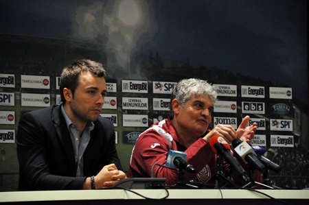 cfr cluj: CLUJ-NAPOCA, ROMANIA - APRIL 22: Coach of CFR Cluj, Mr. Ioan Andone (R) during a press conference after a match against FC C. Chiajna on April 22, 2012 in Cluj-N, Romania  Editorial