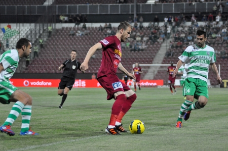 cfr cluj: CLUJ-NAPOCA, ROMANIA � MAY 11: P. Kapetanos (in red) in action at a Romanian National Championship soccer game CFR Cluj vs. V. Sibiu, May 11, 2012 in Cluj-Napoca, Romania  Editorial
