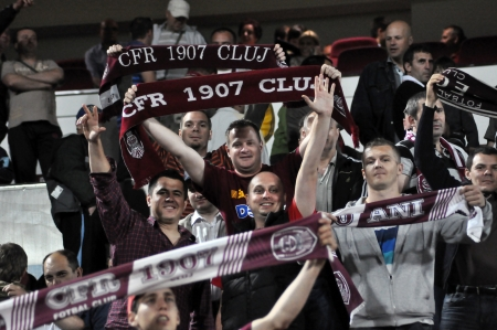 CLUJ NAPOCA, ROMANIA – MAY 11: FC CFR Cluj team supporters shows their support during a game in League 1 against V. Sibiu on May 11, 2012 in Cluj Napoca, Romania  Stock Photo - 13669029
