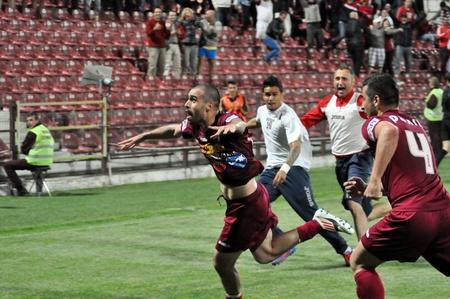 cfr cluj: CLUJ-NAPOCA, ROMANIA – MAY 11: V. Maftei celebrating a goal at a Romanian soccer game CFR Cluj vs. V. Sibiu, final score 2:1, May 11, 2012 in Cluj-Napoca, Romania  Editorial