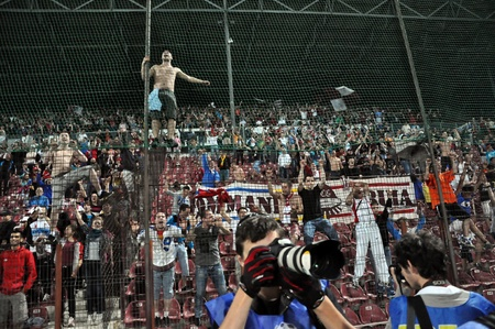 CLUJ NAPOCA, ROMANIA � MAY 11: FC CFR Cluj team supporters shows their support during a game in League 1 against V. Sibiu on May 11, 2012 in Cluj Napoca, Romania  Stock Photo - 13669061