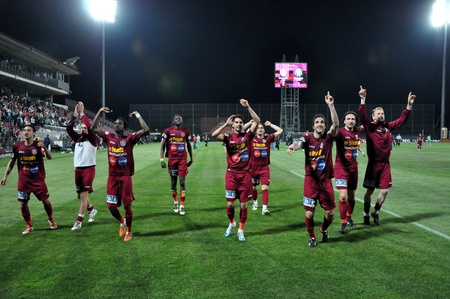 cfr cluj:  CLUJ NAPOCA, ROMANIA – MAY 11: FC CFR Cluj players celebrate the victory against FC Vointa Sibiu, final score 2:1 on MAY 11, 2012 in Cluj N, Romania