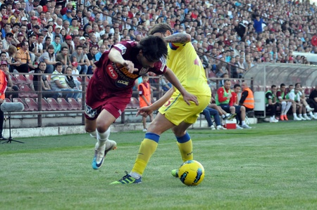 rui: CLUJ-NAPOCA, ROMANIA MAY 20: Rui Pedro (in red) in action at a Romanian National Championship soccer game CFR Cluj vs. Steaua Bucharest, May 20, 2012 in Cluj-Napoca, Romania  Editorial