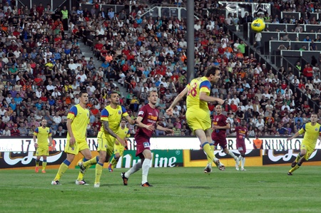 cfr cluj: CLUJ-NAPOCA, ROMANIA MAY 20: N. Martinovici (in yellow) in action at a Romanian National Championship soccer game CFR Cluj vs. Steaua Bucharest, May 20, 2012 in Cluj-Napoca, Romania