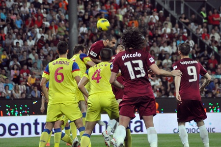 cfr cluj: CLUJ-NAPOCA, ROMANIA MAY 20: Vasile Maftei (in red) hitting the ball at a Romanian National Championship soccer game CFR Cluj vs. Steaua Bucharest, May 20, 2012 in Cluj-Napoca, Romania