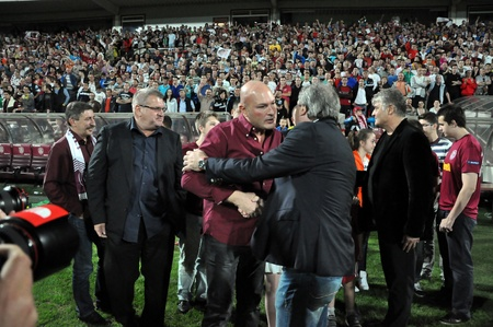 cfr cluj: CLUJ NAPOCA, ROMANIA MAY 20: FC CFR Cluj management celebrating the new league title and the victory against FC Steaua Bucharest, final score 1:1 on MAY 20, 2012 in Cluj N, Romania