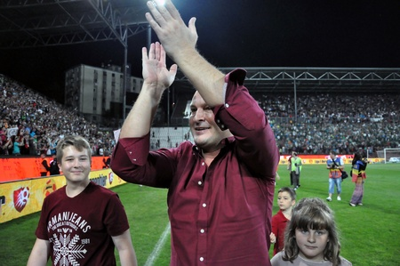 cfr cluj: CLUJ NAPOCA, ROMANIA MAY 20: FC CFR Cluj soccer club owner and businees man, Arpad Paszkany celebrating the new league title , on MAY 20, 2012 in Cluj N, Romania  Editorial