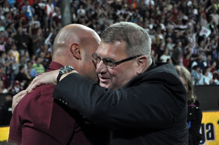 cfr cluj: CLUJ NAPOCA, ROMANIA MAY 20: FC CFR Cluj soccer club owner and businees man, Arpad Paszkany (L) and club manager Iuliu Muresan (R) celebrating the league title , on MAY 20, 2012 in Cluj N, Romania  Editorial