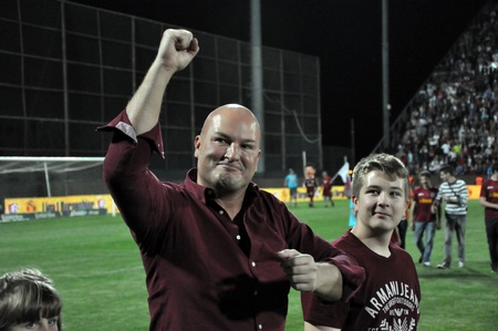 businees: CLUJ NAPOCA, ROMANIA MAY 20: FC CFR Cluj soccer club owner and businees man, Arpad Paszkany celebrating the new league title , on MAY 20, 2012 in Cluj N, Romania  Editorial
