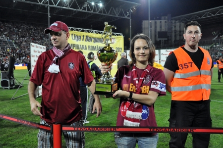 cfr cluj: CLUJ NAPOCA, ROMANIA - MAY 20: Ceremony at the beginning of FC CFR Cluj - FC Steaua Bucharest match with an unidentified girl holding the golden cup, May 20, 2012 in Cluj Napoca, Romania  Editorial