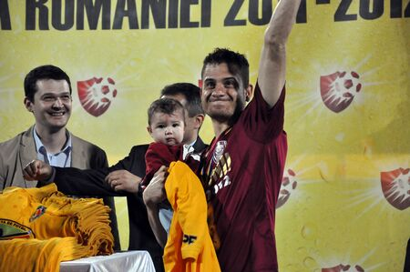 cfr cluj: CLUJ NAPOCA, ROMANIA MAY 20: FC CFR Cluj player, Ronny Carlos celebrating the new league title and the victory against FC Steaua Bucharest, final score 1:1 on MAY 20, 2012 in Cluj N, Romania