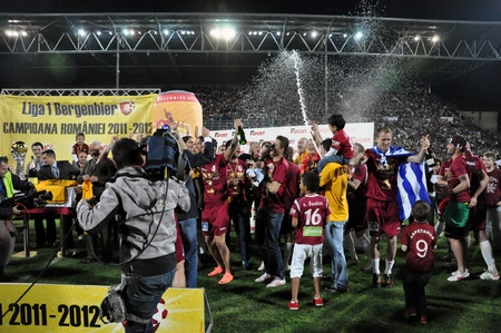 cfr cluj: CLUJ NAPOCA, ROMANIA MAY 20: FC CFR Cluj players celebrating with champagne the new league title and the victory against FC Steaua Bucharest, final score 1:1 on MAY 20, 2012 in Cluj N, Romania