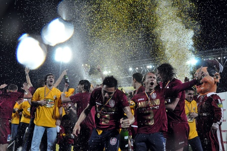 CLUJ NAPOCA, ROMANIA MAY 20: FC CFR Cluj players celebrating with champagne the new league title and the victory against FC Steaua Bucharest, final score 1:1 on MAY 20, 2012 in Cluj N, Romania
