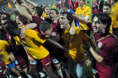cfr cluj: CLUJ NAPOCA, ROMANIA MAY 20: FC CFR Cluj players celebrating the new league title and the victory against FC Steaua Bucharest, final score 1:1 on MAY 20, 2012 in Cluj N, Romania  Editorial