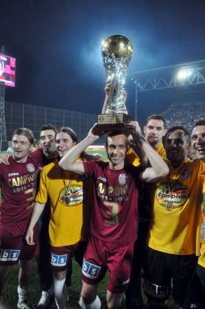 CLUJ NAPOCA, ROMANIA MAY 20: FC CFR Cluj player, Gabriel Muresan celebrate the new league title and the victory against FC Steaua Bucharest, final score 1:1 on MAY 20, 2012 in Cluj N, Romania