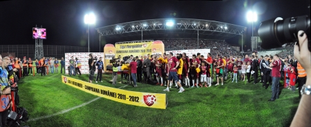 cfr cluj: CLUJ NAPOCA, ROMANIA MAY 20: Panorama with FC CFR Cluj players celebrating the new league title and the victory against FC Steaua Bucharest, final score 1:1 on MAY 20, 2012 in Cluj N, Romania Editorial