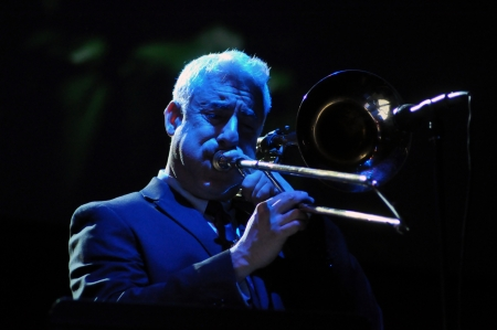 jeffrey: CLUJ NAPOCA, ROMANIA - MAY 29: Jeffrey Budin from Pink Martini pop-jazz band performs live on trombone at the Sports Hall of Cluj, Romania, MAY 29, 2012 in Cluj-Napoca, Romania  Editorial