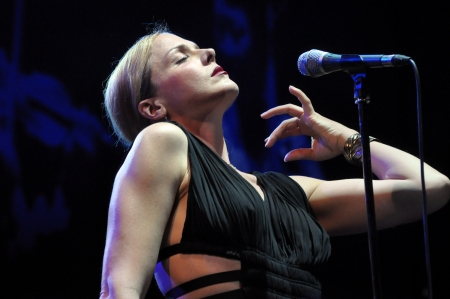 vocalist: CLUJ NAPOCA, ROMANIA - MAY 29: Vocalist Storm Large form Pink Martini pop-jazz band performs live at the Sports Hall of Cluj, Romania, MAY 29, 2012 in Cluj-Napoca, Romania Editorial