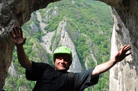rockclimb: Portrait of a climber with a green helmet