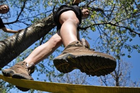 slack: Girl balancing on the slackline in the outdoor
