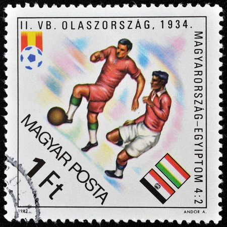HUNGARY - 1982: A stamp printed in Hungary showing football players of Hungary against Italy, 1982