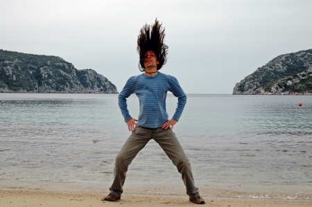 A man with long hair on the beach photo