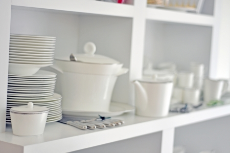 China dish, tableware and cutlery in a bright kitchen Stock Photo