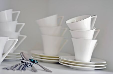China dish, tableware and cups in a bright kitchen photo