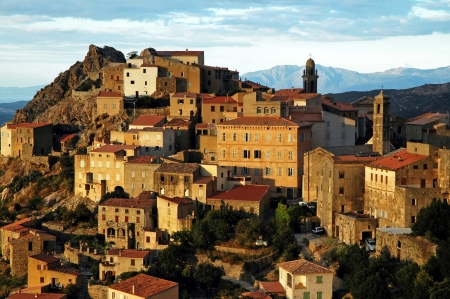 Speloncato village on a rocky height in Corsica, in late afternoon lights photo