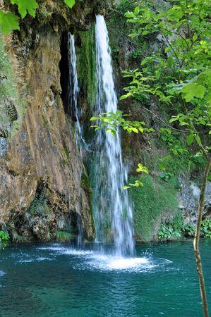 Beautiful waterfall and a turquoise lake in Plitvice, Croatia photo