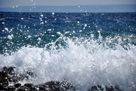 Powerful Waves crushing on a rocky beach photo