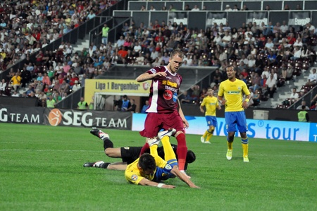 cfr cluj: CLUJ-NAPOCA, ROMANIA - SEPTEMBER 2  Pantelis Kapetanos  red  in action at a Romanian Championship soccer game CFR Cluj vs  Petrolul Ploiesti, final score 2-2, on September 2, 2012 in Cluj, Romania