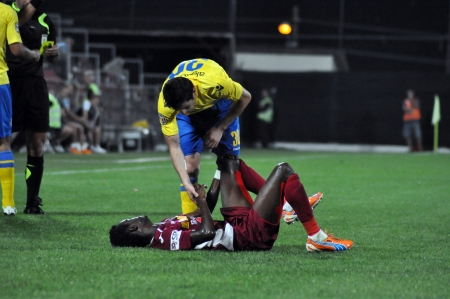 CLUJ-NAPOCA, ROMANIA - SEPTEMBER 2  Fair play of M  Laurentiu  yellow  after a fault against M  Sougou  red  during a match between CFR Cluj - P  Ploiesti, final score 2-2, Sept 2, 2012 in Cluj, RO