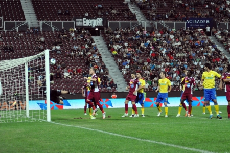 cfr cluj: CLUJ-NAPOCA, ROMANIA - SEPTEMBER 2  Khamutovski Vasili in action at a Romanian National Championship soccer game CFR Cluj vs  Pterolul Ploiesti, , final score 2-2, on Sept  2, 2012 in Cluj, Romania  Editorial