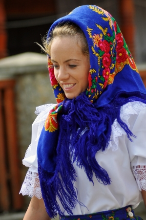 IEUD, ROMANIA - CCA. AUGUST, 2012: Celebration of a traditional Romanian wedding in traditional dresses at the Ieud Village Festival Days, at  August, 2012, in  Ieud, Maramures, Romania  Stock Photo - 16377933