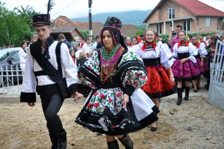 GHERTA MICA, ROMANIA - CCA. JULY, 2012: Celebration of a traditional Romanian wedding in traditional  dresses at July, 2012, in  Gherta Mica, Romania  Stock Photo - 16377945