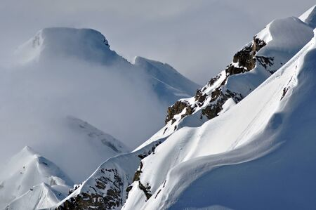 Snow covered mountain ridge, perfect for ski photo