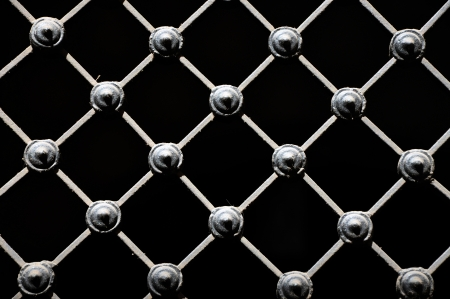 forged: Decorative wrought iron grid, isolated on black