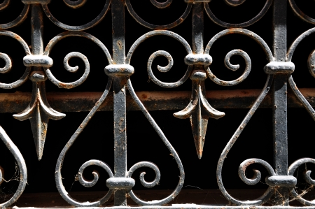iron fence: Decorative wrought iron grid, isolated on black