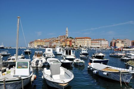 ROVINJ, CROATIA – JULY 30: The harbour of the beautiful town of Rovinj, on JULY 30, 2012 in Istria, Croatia. Rovinj is the pearl of the famous Istria peninsula in Croatia Stock Photo - 17268914